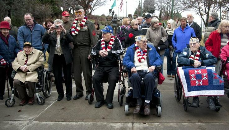 In this Dec. 7, 2014, SR file photo, Pearl Harbor Survivors Association members from left, Bud Garvin, in wheelchair, Ray Garland, in uniform, Clyde Buteau, in a walker, Charlie Boyer, wheelchair, and Sid Kennedy, wheelchair, gather before the newly-installed memorial stone before a ceremony at the Spokane Veterans Memorial Arena, to commemorate the 73rd anniversary of the attack that began America's involvement into WWII. (Dan Pelle/SR photo)