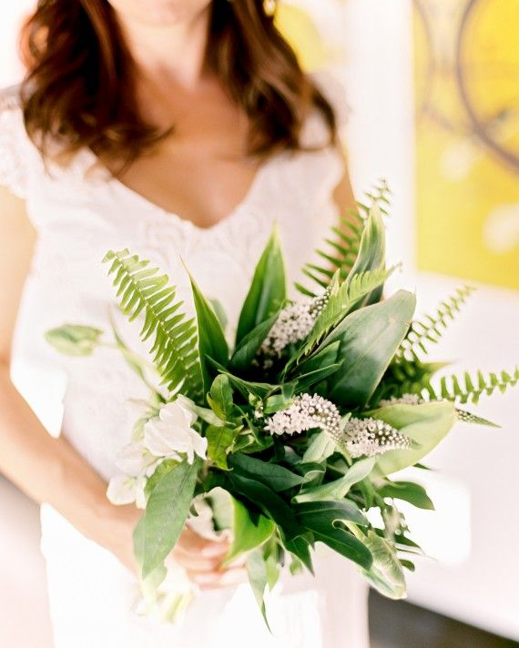 Sydney clutched an arrangement of veronica, tea leaves, sweet peas, parrot tulips, and ferns made by Beet and Yarrow.