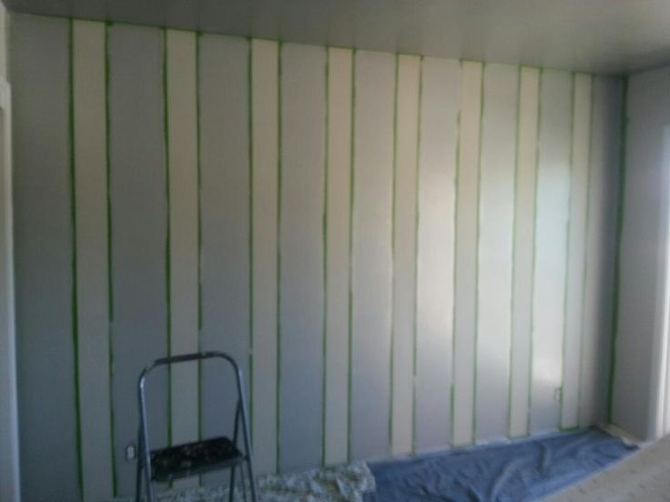 painted vertical striped wall with tape