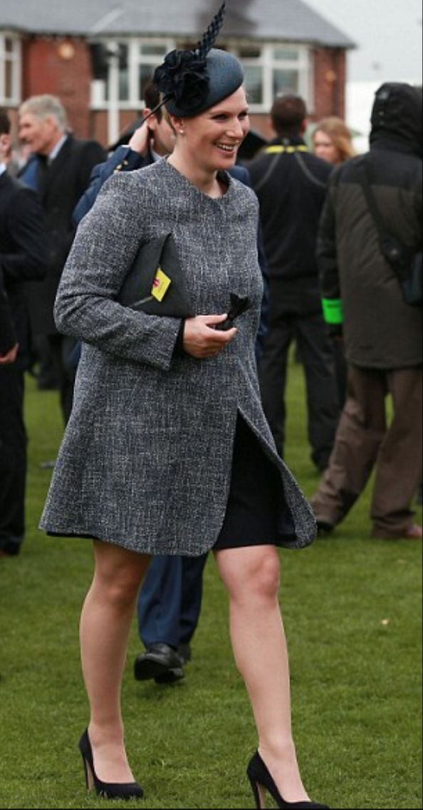 Zara Phillips wears a Gina Foster Millinery 'Lilly' hat from the SS14 Collection to Aintree Races.