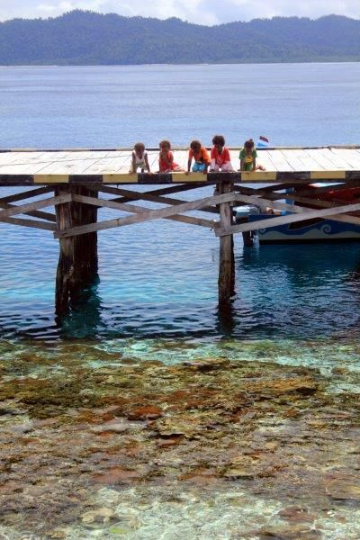 Kids on the jetty at Arborek Island