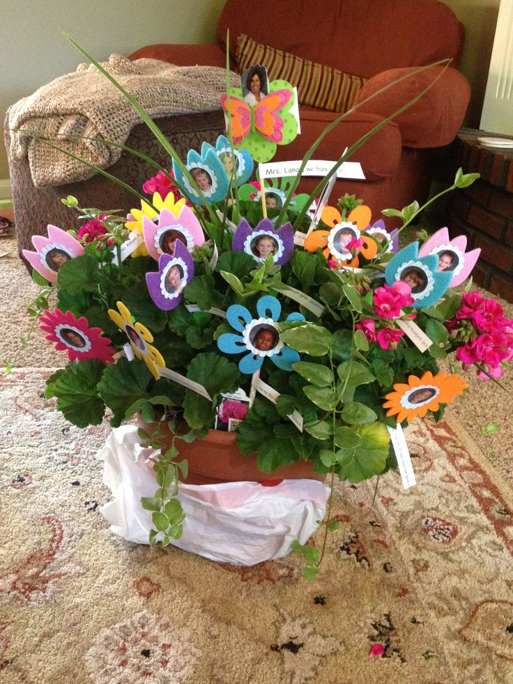 "My sons teachers thank you gift from the class. I quoted a ,""thank you"" from each child and placed that on the stem and then cut out their photo in the shape of a flower. This was super easy and cost-effective."