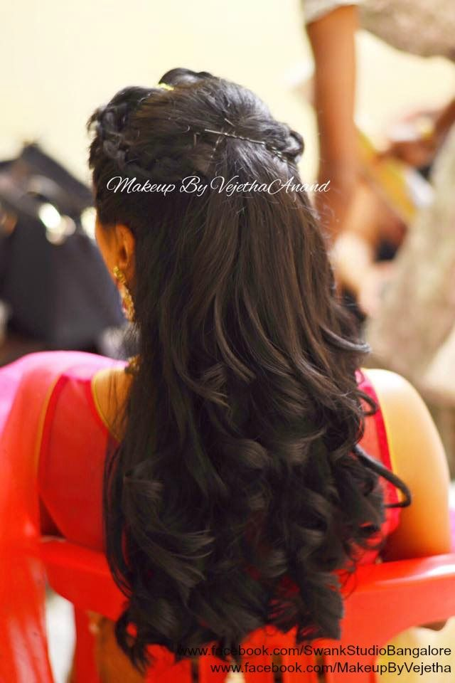 Indian bride's engagement hairstyle by Swank Studio.  Curls. Braids. Updo. Dressy hairstyle. Bridal hair. Tamil bride. Telugu bride. Kannada bride. Hindu bride. Malayalee bride. Find us at https://www.facebook.com/SwankStudioBangalore