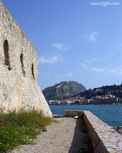 View of #Palamidi Castle from #Bourtzi Fortress across the port of #Nafplio in the #Peloponnese - #Greece