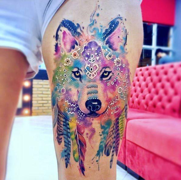 Vivid watercolor wolf tattoo by Erick Silva