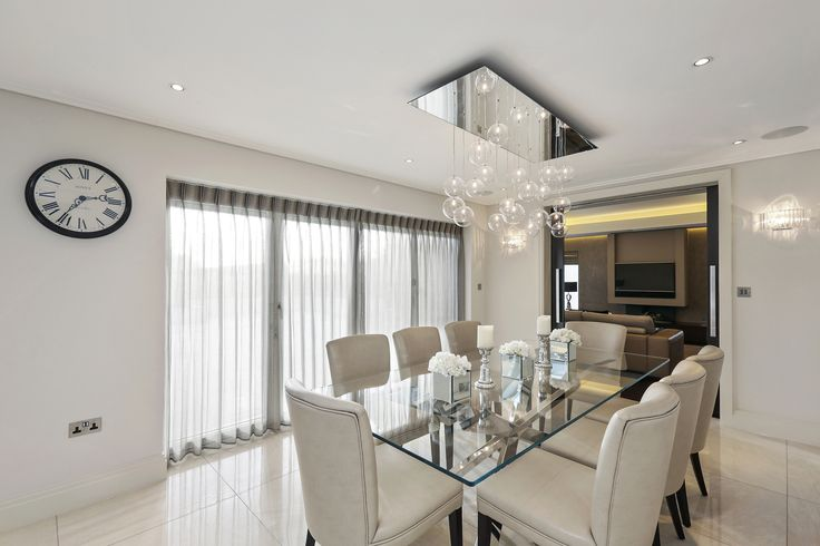 A feature pendant over the dining table sets the scene.  In houses with low ceilings it's one place to be able to have a pendant that you won't walk into.  Feature wall lights give a more peripheral form of lighting to create a more intimate atmosphere.