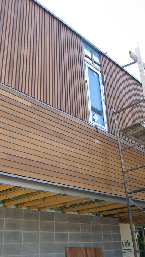 Modern Cedar Horizontal Wood Siding Home With Dark Shingles And Trim Horizontal And Vertical