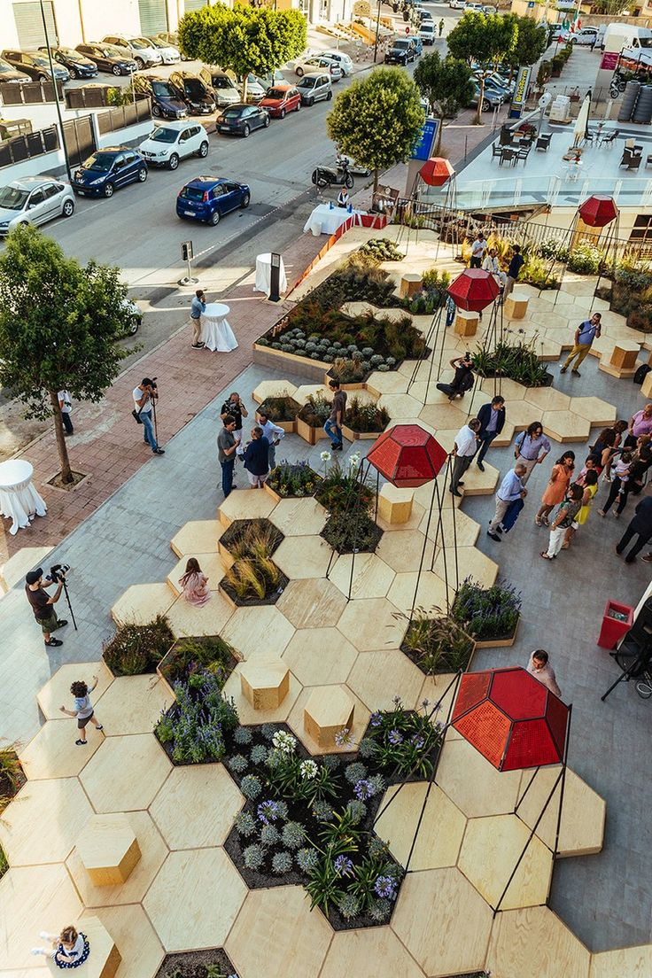 This urban garden, named Zighizaghi, is a multi-sensory garden made of two levels, a horizontal level, the hexagonal floor and seating area, and a vertical level, the lighting and sound systems. There's also numerous plants included in the design, like lemon trees and lavender.