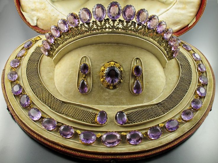 """A yellow gold and amethyst parure composed of one necklace, two bracelets, one brooch, a tiara and a pair of earrings. France, around 1820. In original leather box bearing the word """"Amethyst"""". Photo Pennisi Jewellery"""