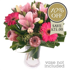 Skyrocket - Make a statement with this innovative collection of pink proteas, gerberas and lilies.