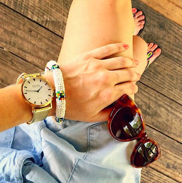 You'll know it's summer time with this gold-faced watch, beaded bangle and a pair of sunnies for the open road.