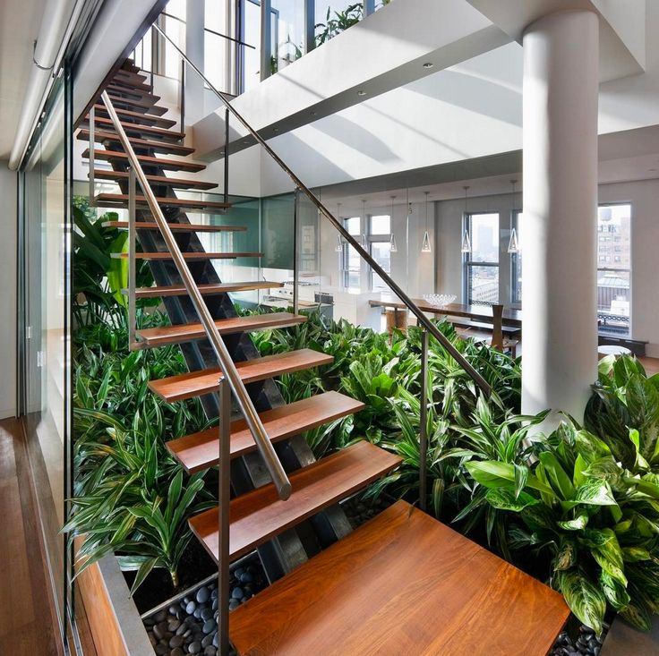 The beautiful NoHo loft renovation in New York City that rethinks the notion of an urban garden by bringing the outdoors inside.
