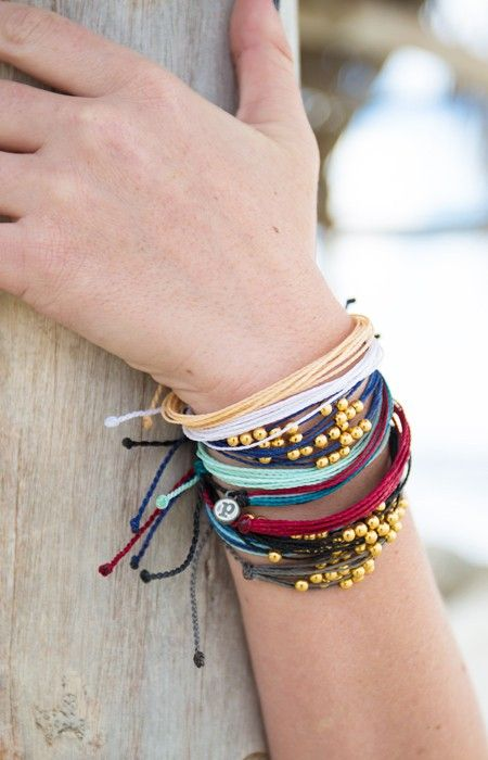 Cute beaded bracelets layered together. Could probably DIY these?