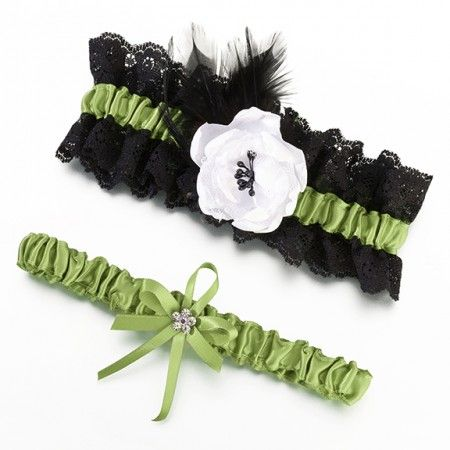 This beautiful set includes two unique garters. The wide garter combines elegant green satin with black lace, black feather and a white satin flower. The small garter is made of elegant green satin with a bow accented by a rhinestone flower. One size fits most.