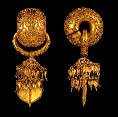 Pair of earrings, Korea, Silla Kingdom, second quarter of the 6th century. Excavated from Bomun-dong Hapjangbun Tomb. Gold; National Museum of Korea.   The most dramatic of Silla earrings, this pair is especially notable for its surface decoration of tiny gold balls, a technique known as granulation. Thought to have developed in ancient Iraq in the third millennium B.C., granulation most likely reached Silla either from the northern kingdom of Goguryeo or via China.