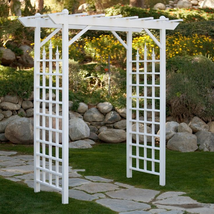 Dura-Trel Camelot 7-ft. Vinyl Pergola Arbor - The Dura-Trel Camelot 7-ft. Vinyl Pergola Arbor creates a dramatic entryway that will set the mood for your entire garden. A trio of decorative finia...