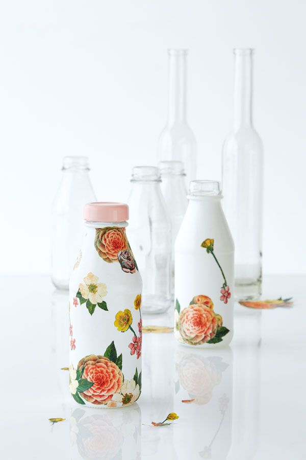 decoupage paper flowers to a glass bottle -- so pretty! not sure what this would be used for...