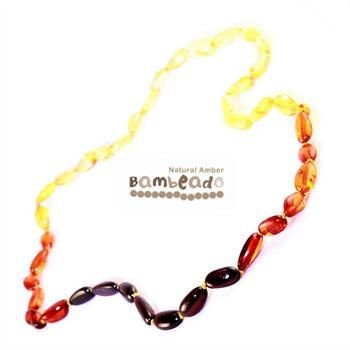This premium amber necklace comes in a rainbow pattern of bean shaped beads from lighter at the back to darker at the front. Amber beads are finished in a polish compared to the standard bud range. The amber necklace is approx 32-34cm in length. Bambeado amber is genuine baltic amber.     Bambeado's are to be worn and not chewed. Each bead is individually knotted to help with safety. The Bambeado comes together with a plastic screw clasp.