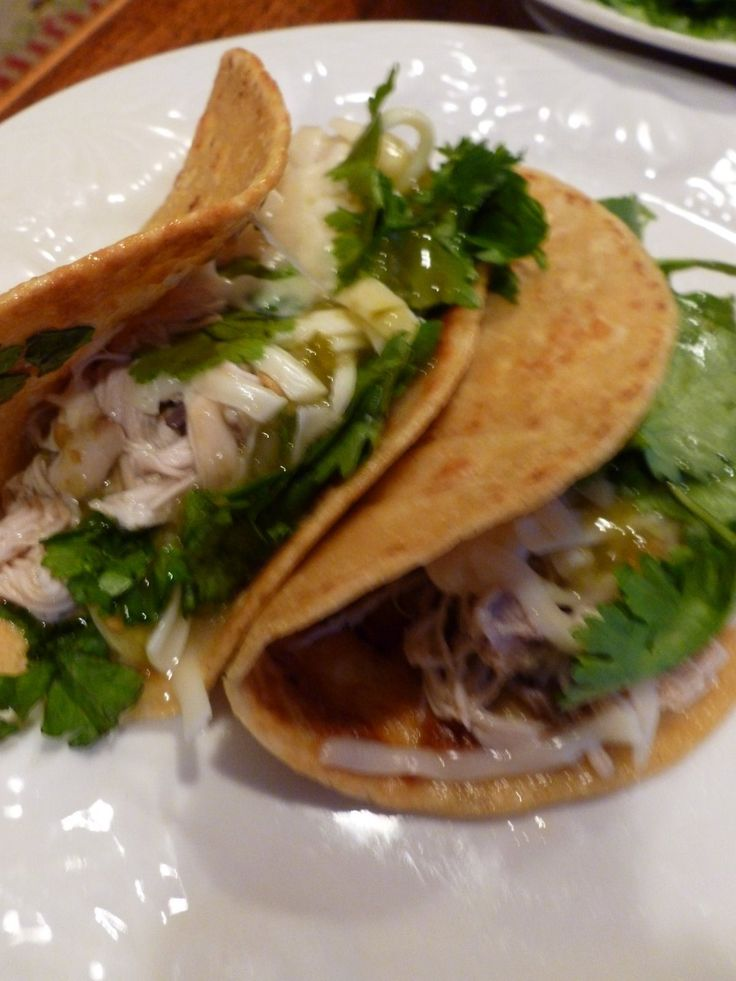 Easy Shredded Chicken Tacos! I have made these so many times and they are delicious, add fresh cilantro! - Moore or Less Cooking Food Blog