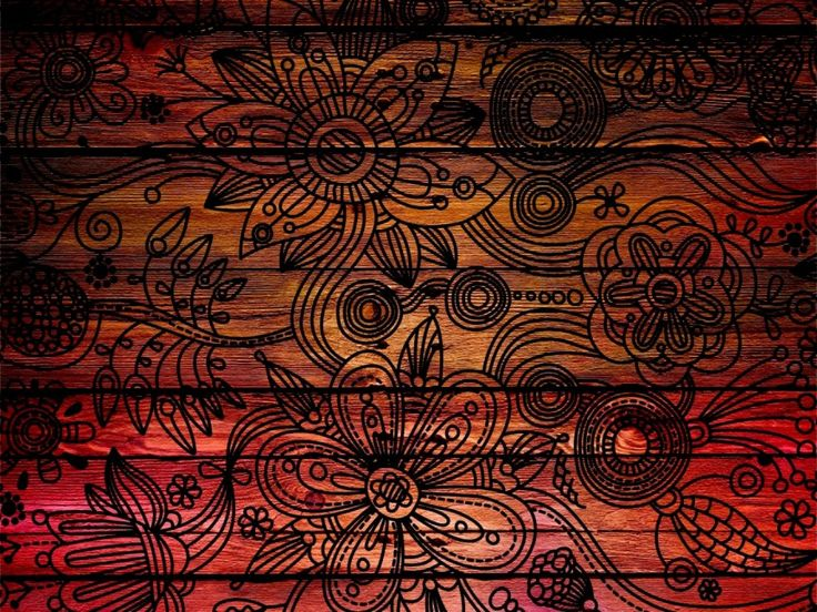 This image demonstrates texture quite clearly. A floral design drawn over or burned in to several wooden boards. You can easily see the roughness of the wood and the wooden boards make it feel grounded and realistic.