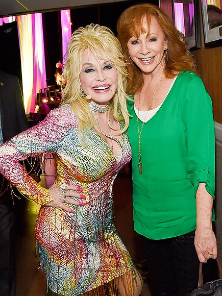 Star Tracks: Monday, August 3, 2015 | COUNTRY QUEENS | Dolly Parton and Reba McEntire flash their signature smiles backstage at Dolly Parton: Pure and Simple, an event benefiting the Opry Trust Fund, in Nashville on Saturday. Two days later, McEntire announced she is splitting from her husband of 26 years.