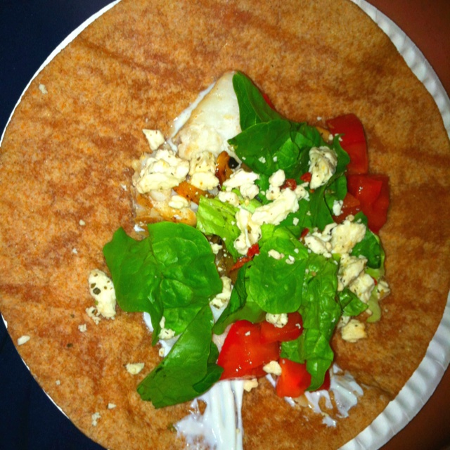 Healthy, yummy low-fat fish taco/burrito recipe!   Whole wheat tortillas Grilled tilapia (with lemon and chili powder) Grilled onions, bell peppers and mushrooms Lettuce Tomato Feta Cheese Plain nonfat Greek yogurt (as a sour cream substitute)  So yummy!
