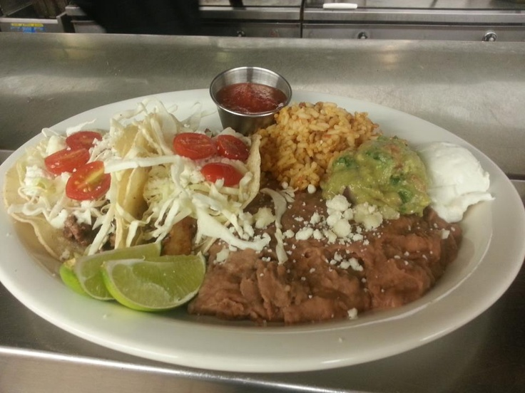 CAB Barrio Tacos: Shredded cabbage, guacamole, grape tomatoes, queso fresco, rice and re-fried beans.