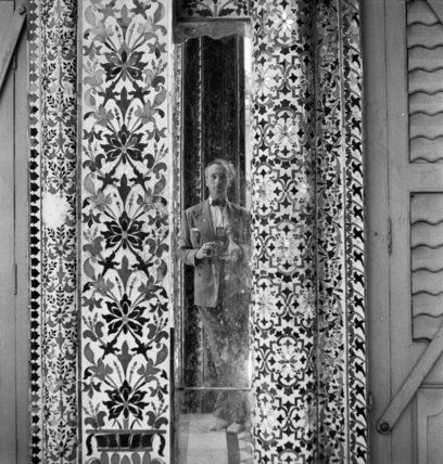 Cecil Beaton reflected in an ornamental mirror in the Parshwanath Jain Temple, Calcutta, India, 1944  Beaton, Cecil  © Crown Copyright: IWM (IB 2357)