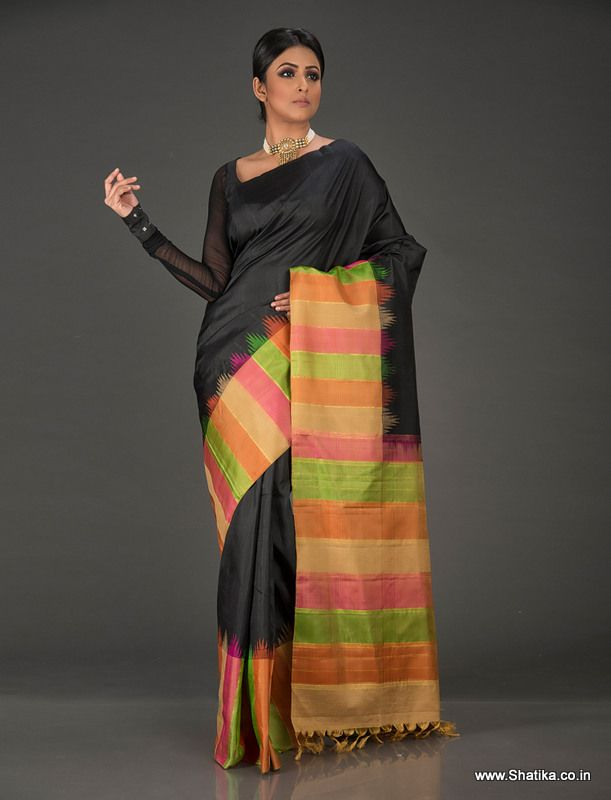 Designed keeping the modern Indian woman in mind is Hamsadeepika Bold Black with Colorful Stripes Patterned Pallu Kanchipuram Silk Saree. Elevating and enlivening the beauty of subtle colors in the backdrop of color black, glide in elegantly showcasing this masterfully made Kanchi Saree as you are sure to be at the center of all attention.