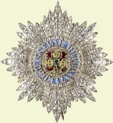 Circa 1838 ORDER OF SAINT PATRICK. Gold, silver, diamonds, rubies, emeralds, and enamel. By Rundell Bridge and Rundell. These stars, all of reduced size to a standard star of the time, formed the pattern for the Queen's subsequent purchases of insignia including the Star of the Order of the Star of India designed by the Prince Consort.