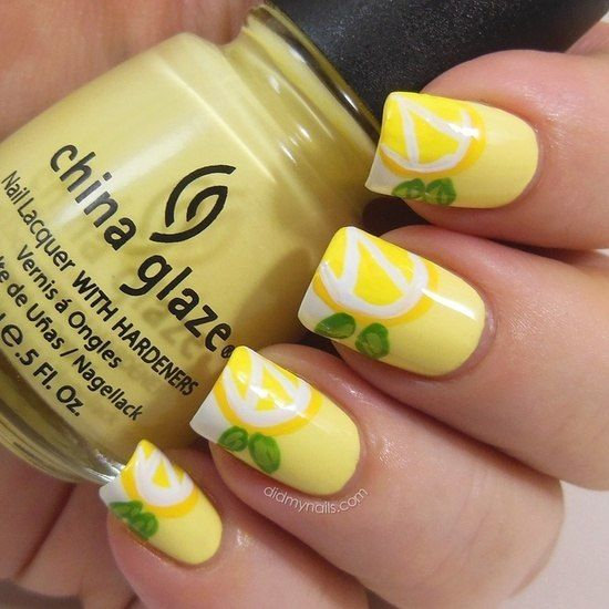 Citrus manicure is perfect for rest and fun pastime on vacation. On a pastel lemon colored base lemon wedges of more bright color with white inking are made. Green leaves bring extra accent. This design option is available even for beginners and can be done in orange or green. It can be combined with nails of any length and shape.