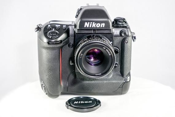 Legendary Famous Nikon F5 Slr Camera With Nikon Af Nikkor 50mm F1 8 Prime Lens And Nikon Mf 27 Data Back Mint Nikon Film Camera Best Film Cameras Nikon Lenses