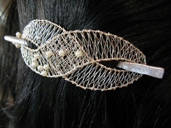 For a shawl pin? More use to me than a hair dooda.