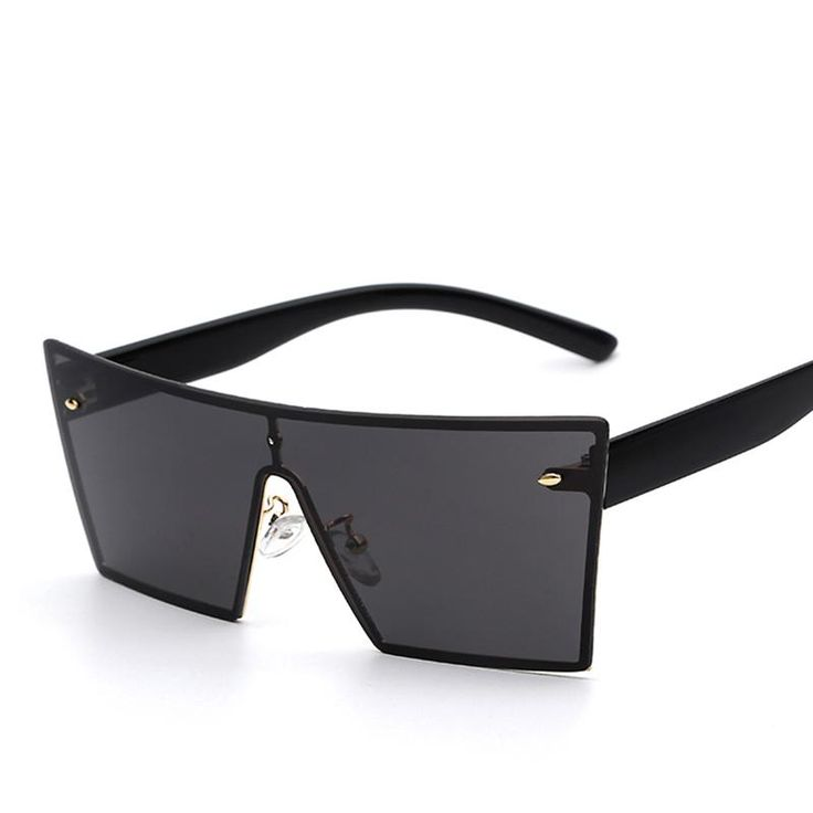 Black Rectangle Sunglasses - Everyone knows protecting your eyes from the harmful rays of the sun is important for keeping your peepers healthy and strong but did you know heavy sun exposure also encourages wrinkles? The delicate skin around the eye area is one of the first places wrinkles show up and these full coverage shades will certainly make you feel on trend as well as helping to keep the skin around your eyes protected.