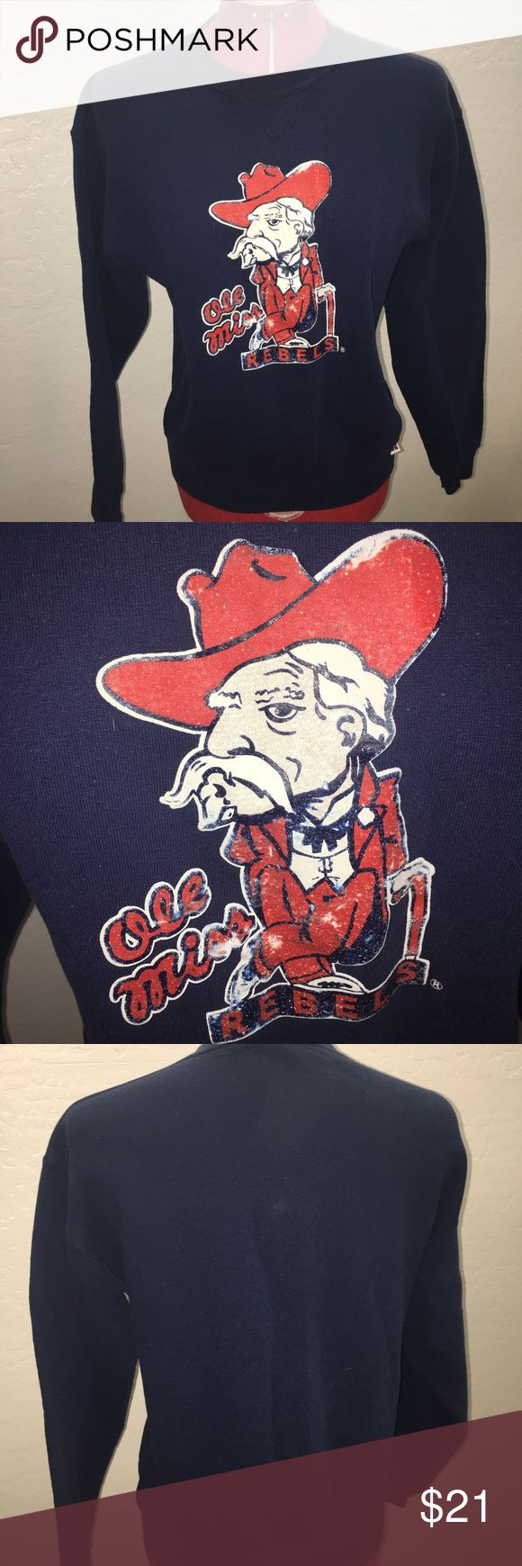 """Ole Miss Vintage Sweatshirt Vintage! Yet has so much life left. Has so much character. Ribbed at the waist and at the neck. No stains or rips. The logo has some fading but it adds to the character of the sweatshirt. Tag says youth Large. Fits as an adult S/M. Cotton blend. 20"""" armpit to armpit. 19"""" across at waist laying flat. 23"""" long from shoulder. There is minor piling. Please see my other vintage listings. BUNDLE & SAVE 20%!! Sweaters Crew & Scoop Necks"""