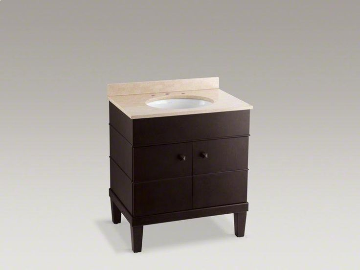 Picture Collection Website With a classic versatile look the bathroom vanity cabinet features a stone countertop with backsplash a moisture resistant finish and adjustable doors