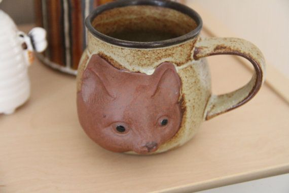 Check out this item in my Etsy shop https://www.etsy.com/au/listing/479615038/vintage-gempo-ceramic-cat-mug