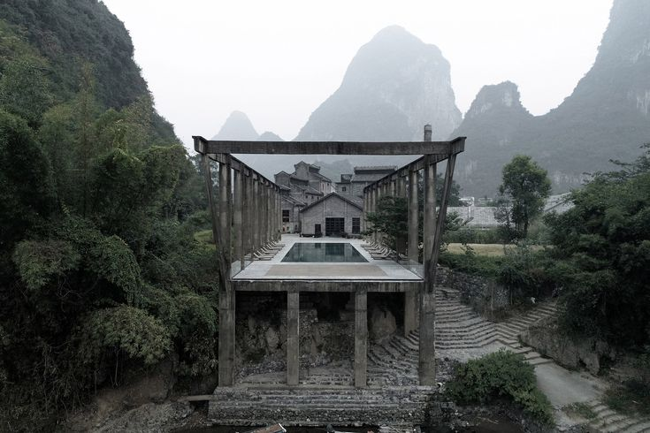 Vector Architects has transformed a disused sugar mill in China's Yangshuo County into a hotel featuring a group of gabled masonry structures.