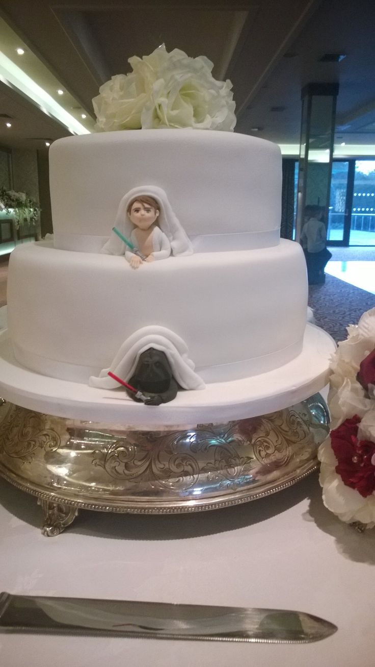 My wedding cake with a twist! Star Wars!! Coming out of the back of the cake like a surprise!