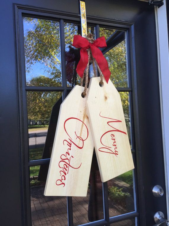 Large door tags just in time for the holidays! Made from beautiful pine, stained and handprinted. These tags are sealed with polyurethane to withstand the weather outside. The tags themselves each measure 18 x 7.5. Total size of this door hanger is 29 tall and 17 wide at the bottom. They are hung by jute rope and topped off with a simple ribbon. This set of tags is handcrafted causing slight variations in letter placement and markings. Each piece has its own character and individuality…