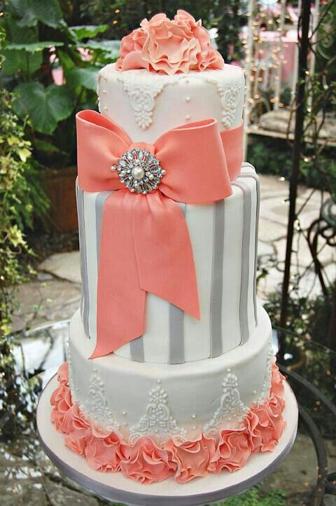 Grey and coral wedding cake with floral cascade, this would be perfect with navy or yellow flowers. Description from pinterest.com. I searched for this on bing.com/images