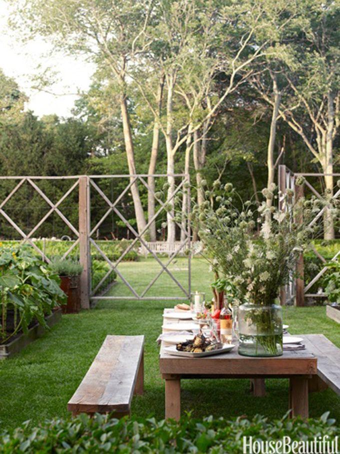 outdoor dining space in fenced garden