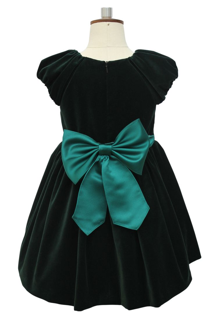 Just imagine your daughter wearing this superb green velvet dress to open her presents on Christmas Day. This rich piece is one of the stylish autumn/winter exclusive girls dresses from the David Charles collection, and is made from a deep and beautiful green velvet perfect for a special occasion. With a gathered skirt and puff sleeves, your little one will look adorable. The skirt and bodice are separated with a red and green jewel encrusted belt giving it a really festive look ideal for…