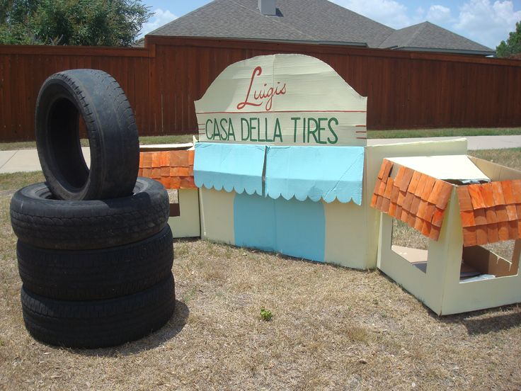 Radiator Springs Casa Della Tires made from five cardboard boxes, paint, and 60 toilet paper rolls (for the shingles), and held together with hot glue, duct tape, and bamboo poles.