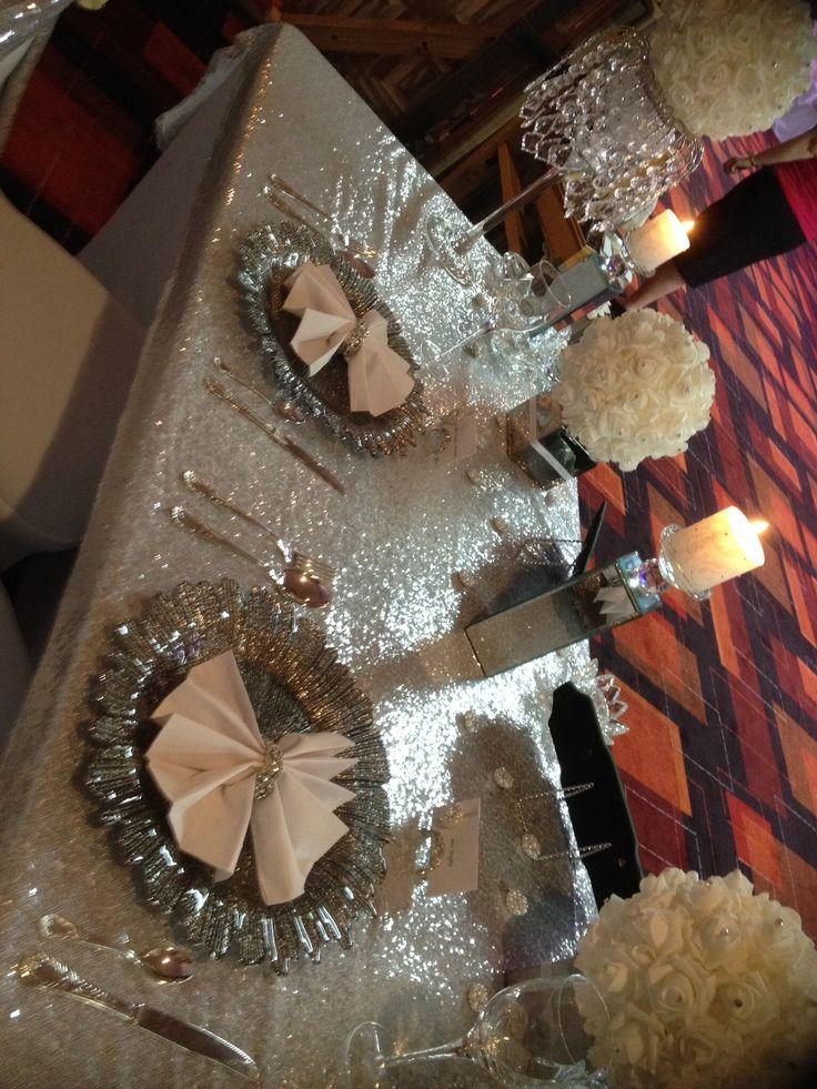 Silver charger plates, Diamanté place card holders, diamanté serviette rings. Table bling, sequin tablecloths