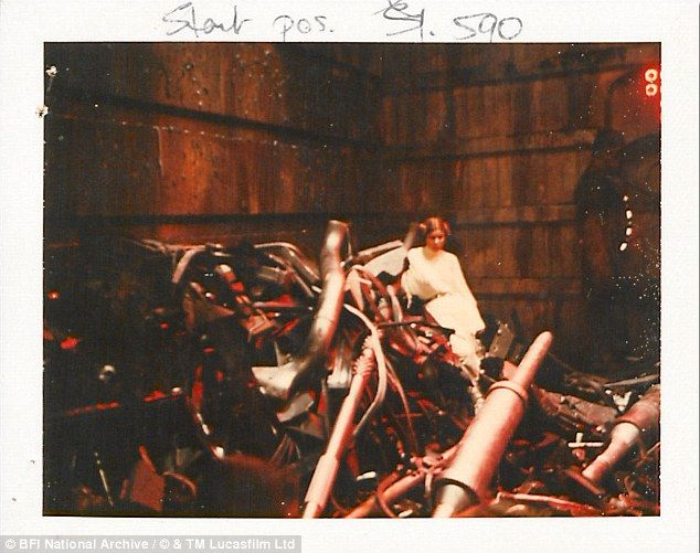 One of the original film's best known characters Princess Leia, played by Carrie Fisher, is pictured on a pile of scrap metal during one scene