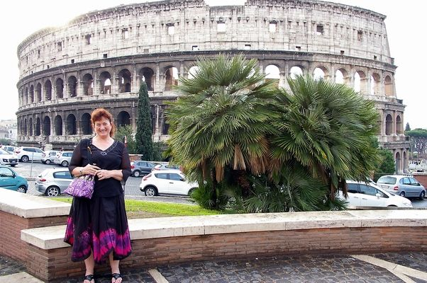 Sharon looking lovely in front of the Colosseum Rome