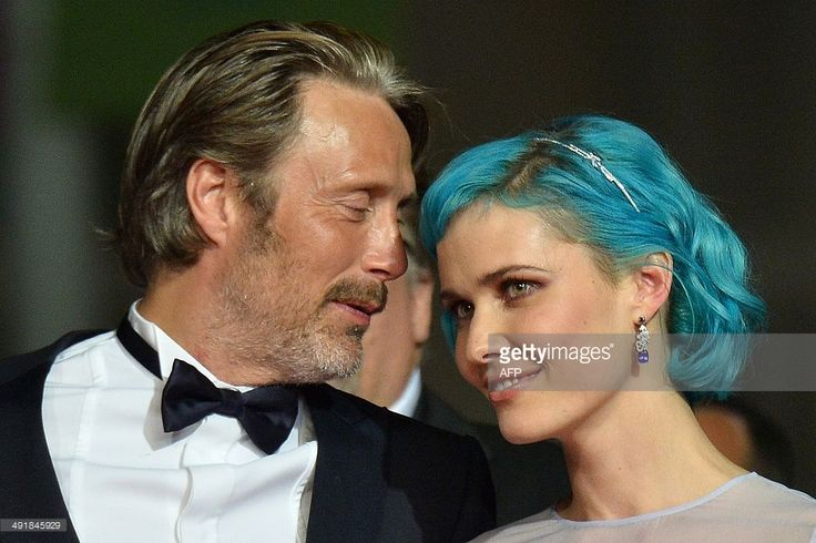 Danish actor Mads Mikkelsen talks with Danish actress Nanna Oland Fabricius as they arrive with Danish actor Toke Lars Bjarke for the screening of the film 'The Salvation' at the 67th edition of the Cannes Film Festival in Cannes, southern France, on May 17, 2014. AFP PHOTO / ALBERTO PIZZOLI