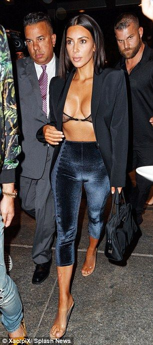 Walk this way: Kim Kardashian showcased her gym-honed figure in the barely-there ensemble...