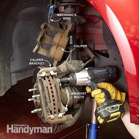Remove the caliper bracket bolts from the brake assembly. How to Change Front Brake Pads: http://www.familyhandyman.com/automotive/car-brakes/how-to-change-front-brake-pads/view-all